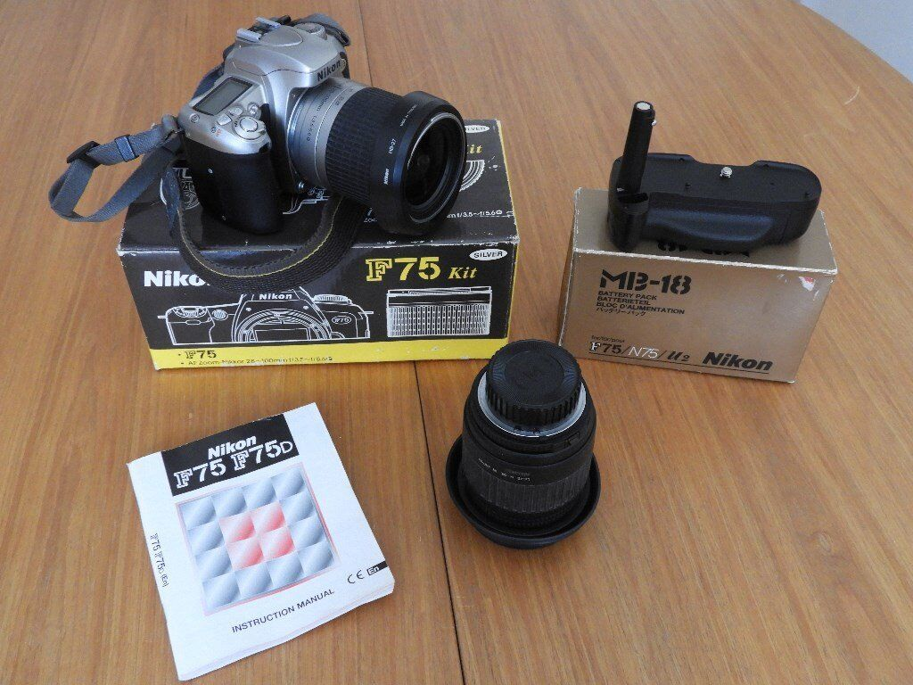 Nikon F75 35mm film camera with 28-100mm zoom lens,MB-18 battery pack and Sigma 28-200mm zoom lens