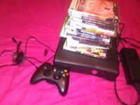 Xbox 360/ellite 250gb online ready comes with a few games con