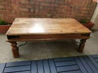 Solid wood (possibly oak) coffee table