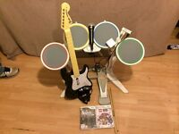 Rockband bundle for the Wii includes drumkit, guitar, microphone and 2 games.