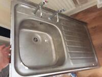Kitchen sink with taps