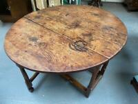 Fabulous early 18th century oak top fruitwood base drop leaf table