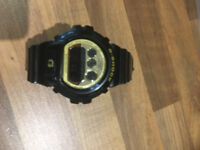 Casio G-Shock DW6900CB-1CR Watch in black with Gold face