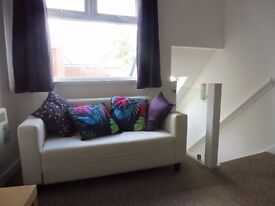 Smart new build studio flat, double bed plus ensuite, separate kitchen and small sitting room