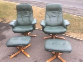 Pair of Leatherette Swivel Reclining Chairs Plus Foot Stools