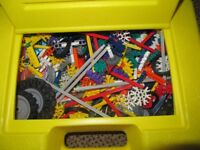 Large box of K'nex in yellow box, with instructions for models