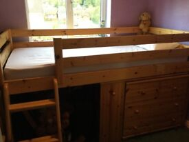 Pine mid-sleeper bunk bed with desk and chest of drawers
