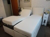Double adjustable bed with separate side controls