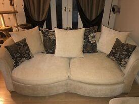 Two Cream sofas.