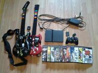 playstation 2 + 1 manette + jeux + 2 guitares hero