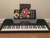 Yamaha psr-175 key board and music book