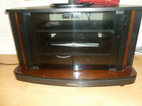 Philips wooden TV table in very good condition.can put dvd players, set top box and speakers as well