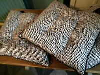 Three cushion pads with ties