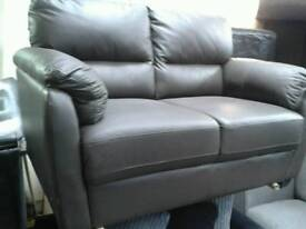 New brown 2 seater leather sofa huge savings
