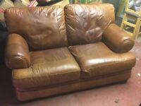 2 seater quality leather sofa , slight fault with one of the legs hence the price
