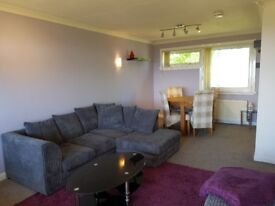 Matching grey 3 seater L shaped couch, 2 seater couch and footrest for sale