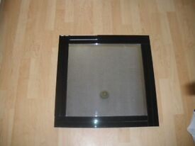 Unusual black glass framed mirror