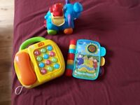 3 Musical Toys- Teletubbies- Time to Rhyme, Fisher Price 2 in 1 phone, Elephant push n go