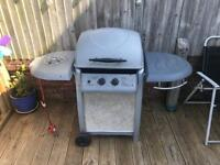 Blooma Laguna 2 burner BBQ with side burner. Comes with protective cover and brand new gas bottle.