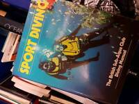 A job lot of books about scuba diving, sharks and marine life