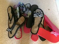 Eight pairs of unused flip flops