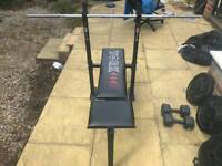 York bench press, barbell and 125kg cast iron + vinyl weight plates