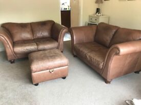 Leather two seater sofas and footstool