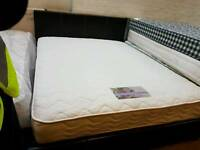 Black leather king-size bed frame with memory foam mattress