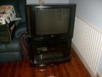 A SINGLE UNIT ANALOGUE TV AND STAND