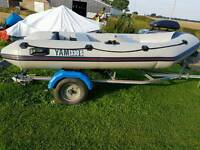 Rib boat with 6 hp out board and trailer