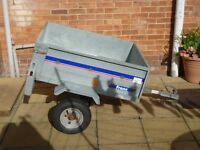 small tipper trailer with new cover.