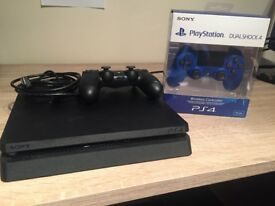 PS4 slim black (500GB) console used just once plus a 2nd Pad