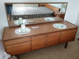 Dressing table and headboard with bedside tables attached