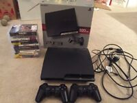 PS3 console slim 320GB, 2 controllers, 13 games