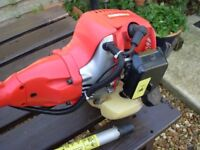 Petrol Mowerland strimmer, and Hedgecuter Attachment,Excellent Condition.Hardly Used