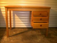Small desk withcollapsable chair. It is made from pine and is 105mm wide x 60mm deep x 74mm high.
