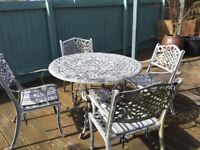 Round metal garden table and 4 chairs (very heavy)