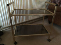 Vintage Antique Tea Trolley Gold Satin Finish With 2 Smoked Glass Shelves