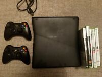 Xbox 360 with 2 controllers + 5 games