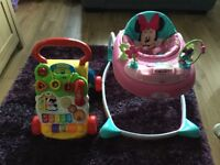 2 children's toddler walkers, 1 a pink Minnie Mouse sit down walker the 2nd a Vtech first steps