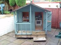Wooden Playhouse and Picnic bench /sandpit