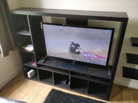 Brown wooden tv stand shelving unit