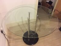 Glass top table and 4 chairs for sale