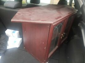 Living room cabinet, glass front doors. Suitable for storage or display