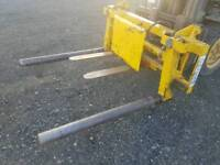 Tractor grays front loader bale handler rollers squeeze