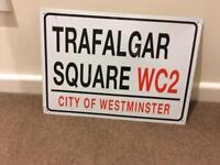 Trafalgar Square metal road sign