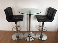 Table and Chairs: Glass Bar Table and two Black Leather Bar Stools