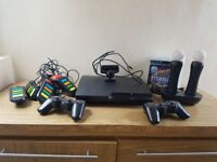 Playstation 3 320GB with 2 controllers, playstation move and Buzz plus 9 games
