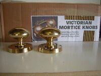 Brass Victorian style door knobs