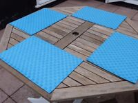 Eight turquoise place mats